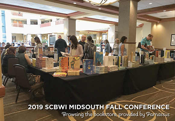 Browsing the bookstore at the 2019 SCBWI Midsouth Fall conference (bookstore provided by Parnassus)