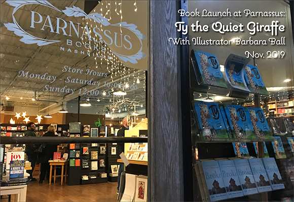 Copies of Ty the Quiet Giraffe, illustrated by SCBWI Midsouth member Barbara Ball, are displayed in the front window for book launch at Parnassus in Nashville.